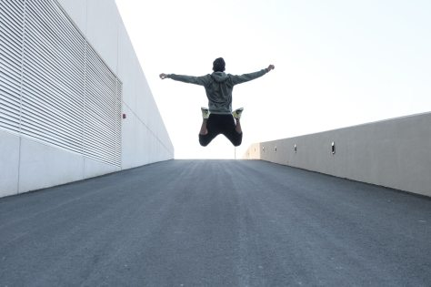 man-in-gray-hoodie-jump-with-open-arms-1432580